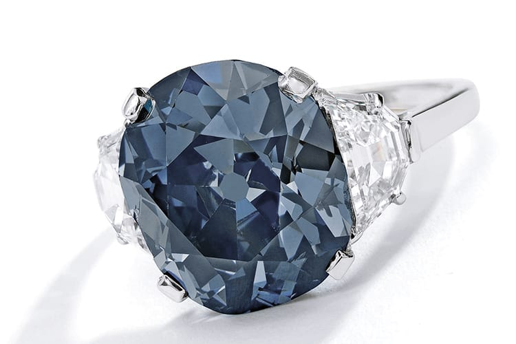 'The Indian Blue,' an exceptional fancy deep grayish blue diamond and diamond ring. Centering a cushion-cut fancy deep grayish blue diamond weighing 7.55 carats. Natural color, SI2 clarity. Estimated to be $6 million to $8 million. (Photo Courtesy of Sotheby's)