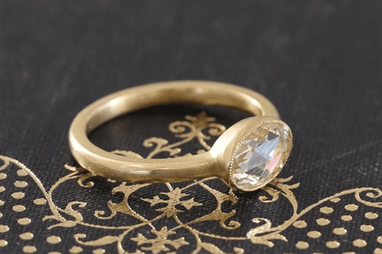 1.54 fancy yellow oval rose cut diamond bezel engagement ring ideas. Jewels by Grace.