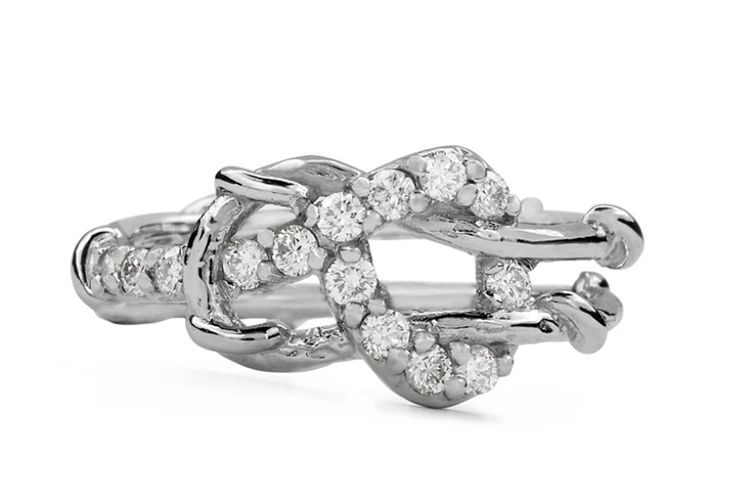 1.7 mm brilliant cut colorless diamond love knot in platinum. Photo courtesy of Karen Karch.