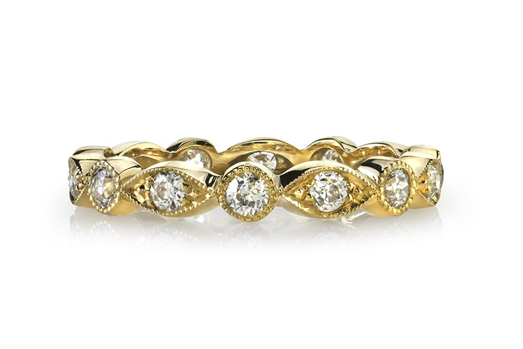 Single Stone at Greenwich St. Jewelers Alternating marquise- and round bezel-set .68 TCW, 18K gold
