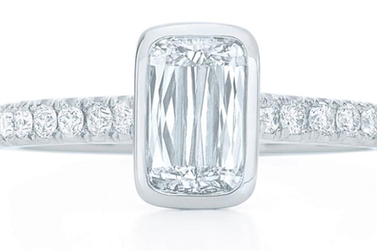 Ashoka cut diamond ring bezel set with pave diamond band set in platinum. Photo courtesy of Kwiat.