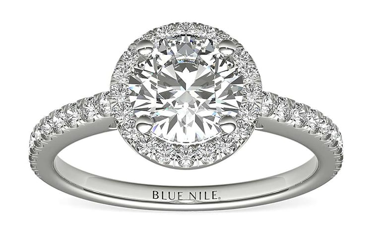 Classic halo ring with diamond shank in platinum. Photo courtesy of Blue Nile.