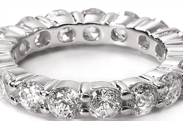 Crislu sterling silver round stone eternity band ring. (Photo by Bloomingdales)..webp