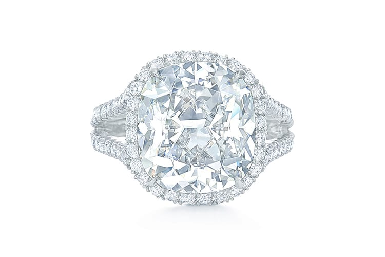 Cushion cut diamond ring with split diamond band and diamond frame set in platinum. (Photo by Kwiat).