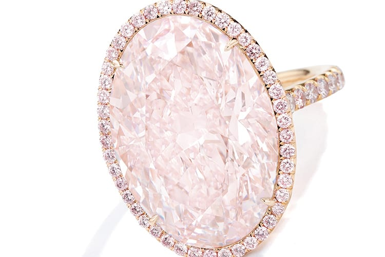 Faint pink diamond and colored diamond ring, set with an oval-shaped faint pink diamond weighing 17.25 carats, framed and accented by round diamonds of pink hue. Faint pink, natural color, VVS1 clarity, with excellent polish and symmetry. Estimated to be $1 million to $1.5 million. (Photo courtesy of Sotheby's)