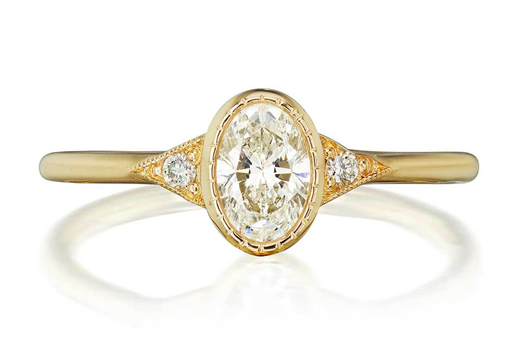 Jennie Kwon's Oval Diamond Deco engagement ring in 14K yellow with an approximately .50-carat center stone; I Color SI1 Clarity. (Photo courtesy of Jennie Kwon)