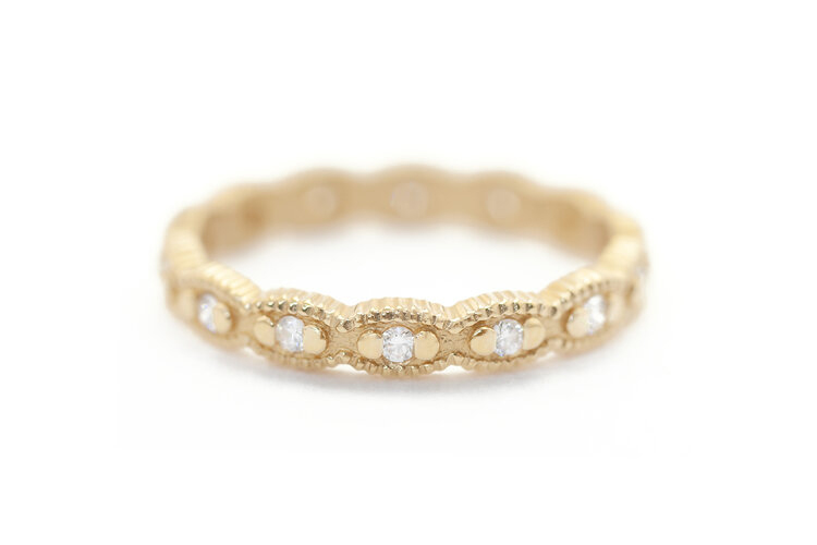 Megan Thorne marquise-shaped 18k setting with prong-set round diamonds]
