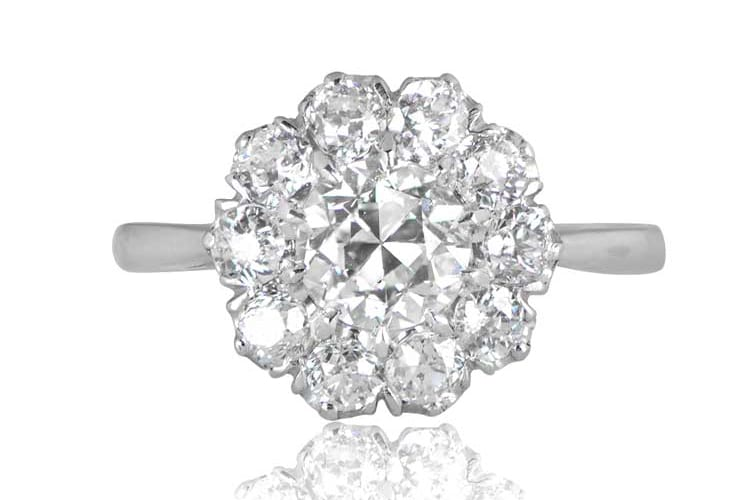 Norfork cluster engagement ring with a row of old mine cut diamonds, hand-crafted in platinum.