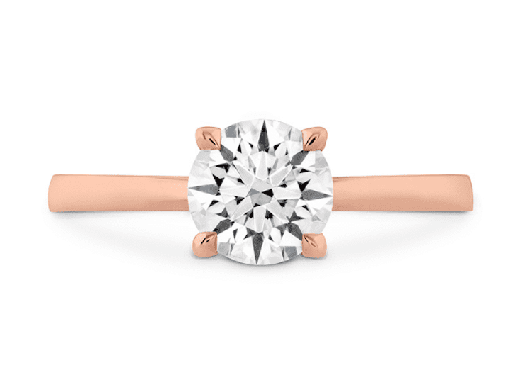 The quintessential solitaire is all about simplicity, like this rose gold band crowned with a round-brilliant diamond set with four prongs. From $2,360