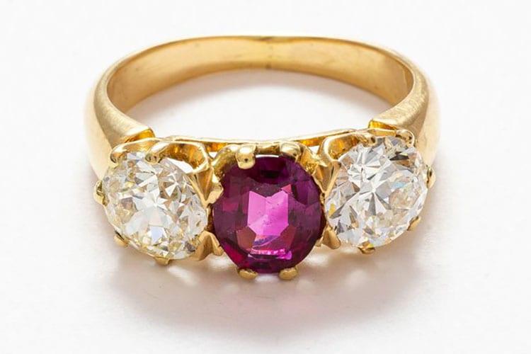 Gray & Davis 14K yellow gold early Edwardian three stone ring of European cut diamonds and center oval ruby.