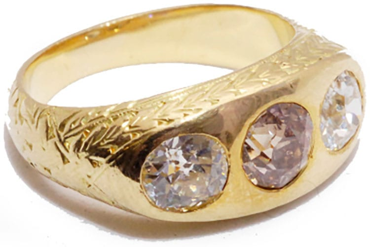 Three stone gypsy ring 18K yellow gold with an engraved shank, set with a brown mine cut center diamond and white mine cut on the sides. American, circa 1880. (Photo courtesy of Sandra Cronan)