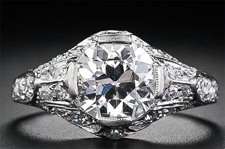 Lang Antiques Edwardian hand fabricated platinum and 1.600carat European cut diamond engagement ring with fine piercing, engraving and millegrain work.