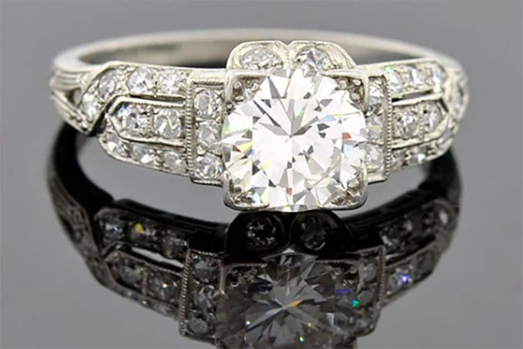 A. Brandt & Sons Art Deco ring with 1.07-carat mine cut diamond ring in a diamond encrusted and finely pierced platinum setting.