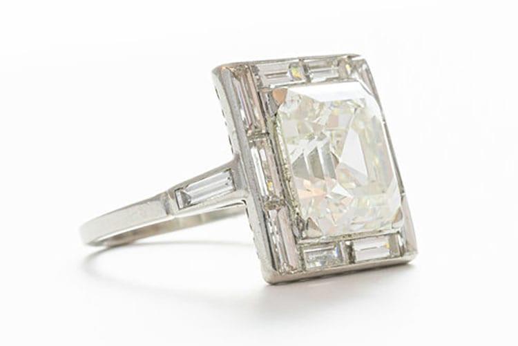 Gray & Davis Art Deco 5.35-carat emerald cut diamond-framed by a surround of channel set baguettes.