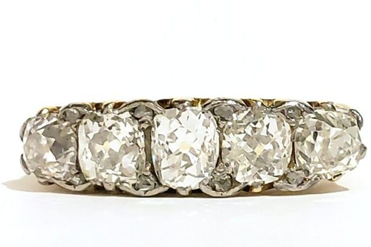 Early Edwardian 18K five-stone mine cut diamond ring with platinum tipped prongs. (Photo courtesy of Gray & Davis)