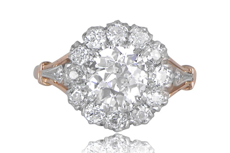 Yorkshire cluster diamond engagement ring that centers an old European cut diamond, hand-crafted in platinum and yellow gold.