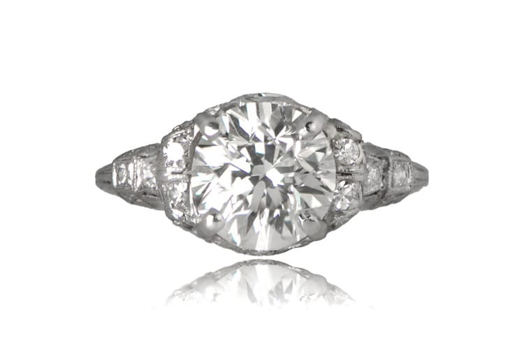 Estate Diamond Jewelry An original Art Deco platinum engagement ring with 2.01-carat old European cut diamond, the ring is further decorated with a scroll motif along the shoulders and filigree. Diamonds are set throughout the details, circa 1920. (Photo courtesy of Estate Diamond Jewelry)