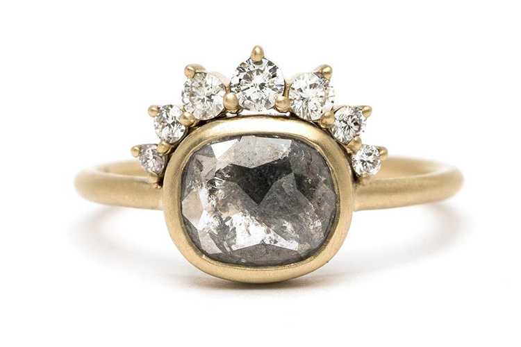 Sofia Kaman's ring combines rough and refined elements in rustic 1.04-carat salt and pepper diamondset in a chunky matte gold bezel and framed with a bohemian style tiara of seven graduated brilliant cut diamonds. Round brilliant cuts are approximately 0.25 TCW and Color/Clarity is G-H/SI. $4,730. (Photo courtesy of Sofia Kaman)