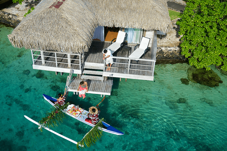 Get breakfast delivered from a canoe French Polynesia