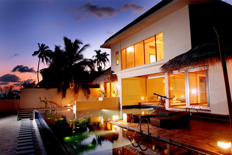 Maldives Honeymoon - View of beach front villa at dusk