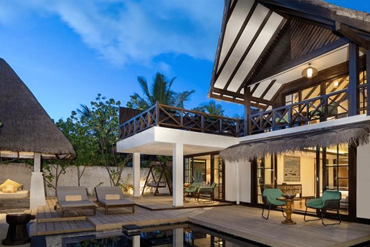 Maldives Honeymoon - View of luxury villa and deck at dusk