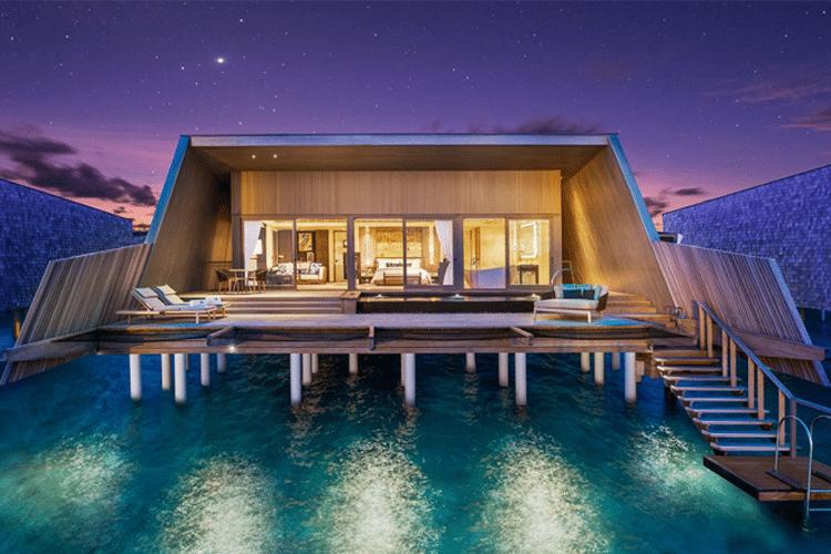 Maldives Honeymoon - View of villa and porch over water at night