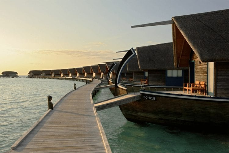 Maldives Honeymoon - View of houseboat-style resort suites lining dock