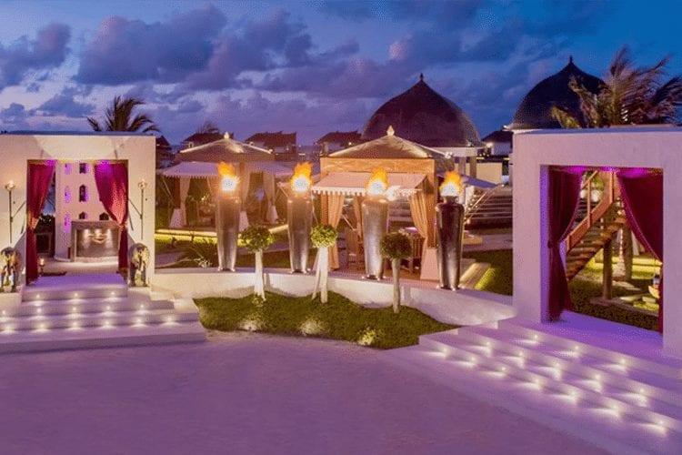 Maldives Honeymoon - View of open air restaurant lit up at night