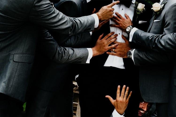 Groomsmen surround the groom