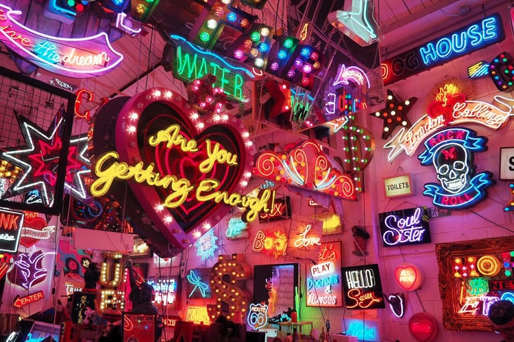 Array of neon signs in art gallery