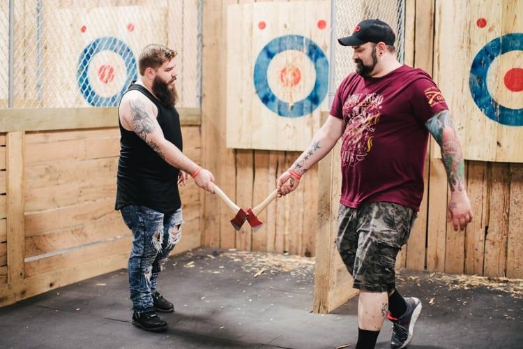Bachelor Part Louisville - two dudes with bears at an axe-throwing range