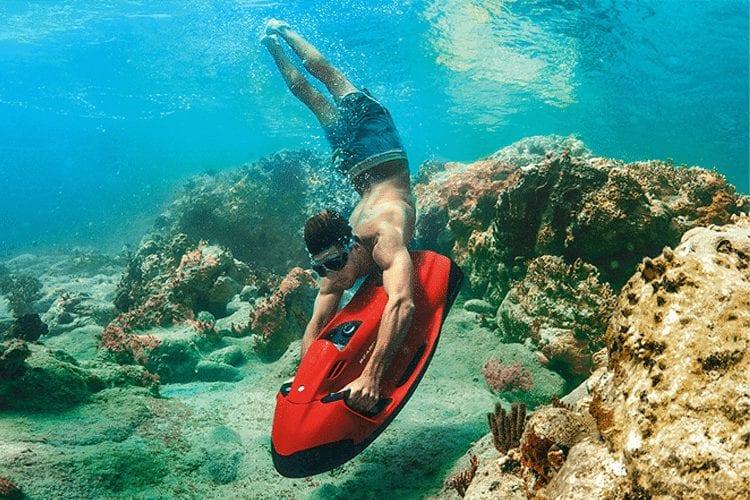 Maldives Honeymoon- Man underwater exploring the ocean floor riding the Seabob