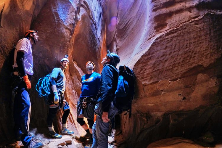Bachelor Party Extreme Sports - Men in canyon gaze upwards