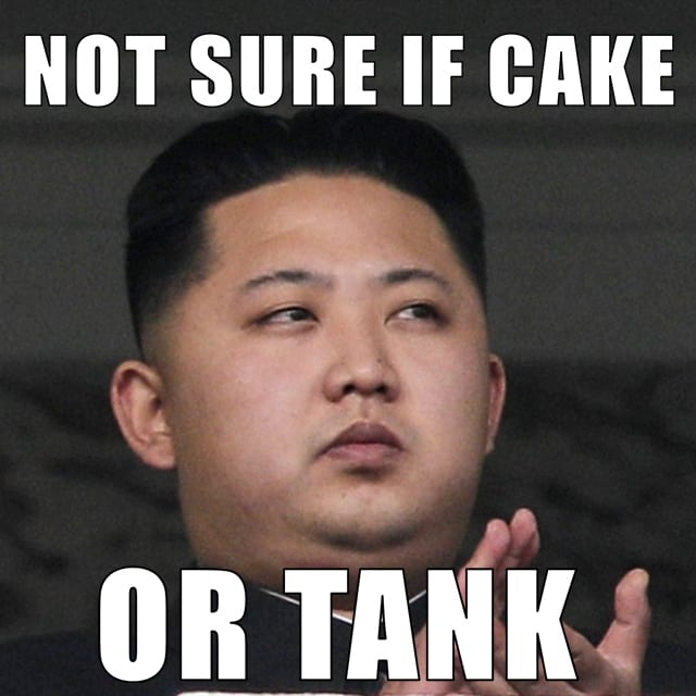 Kim Jong Un is not sure if he's looking at a cake or a tank.