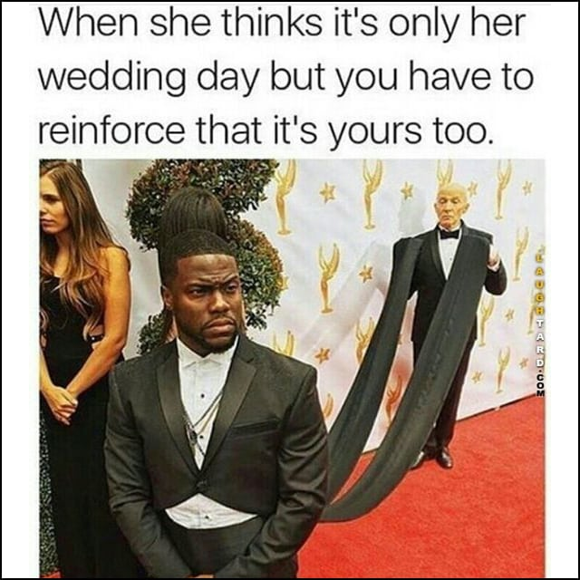 Kevin Hart, being so extra, has an assistant holding his super long coat tails to reinforce that this is his wedding day too.