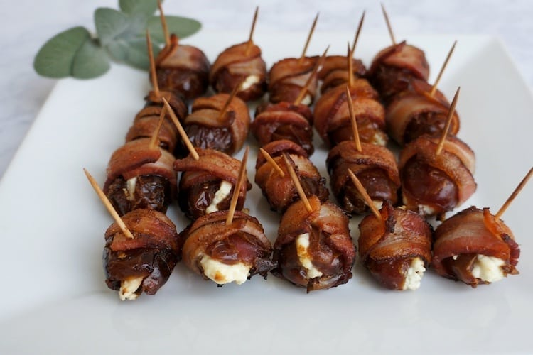 Plate of bacon wrapped dates with toothpicks