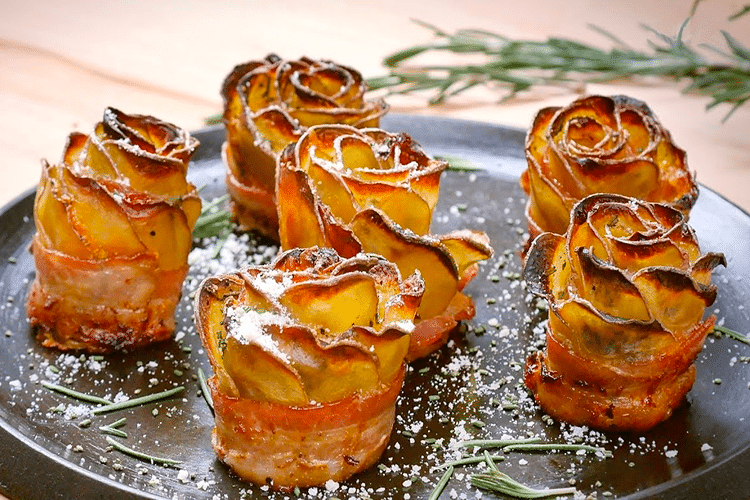 Rose shaped appetizers made of potato slices and wrapped in bacon