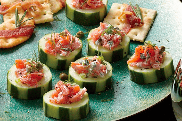 Plate of smoked salmon on cucumber slices