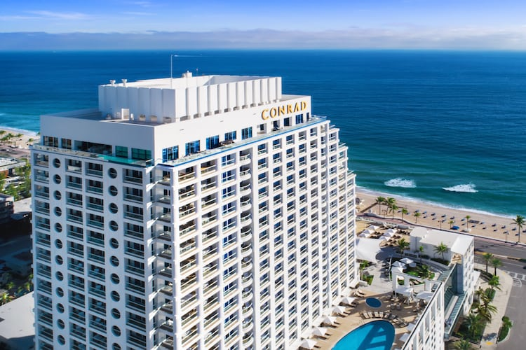 Exterior view of The Conrad Fort Lauderdale and skyline