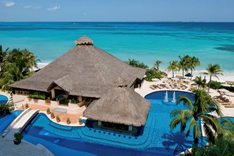 View of resort with pool and ocean in Cancun.