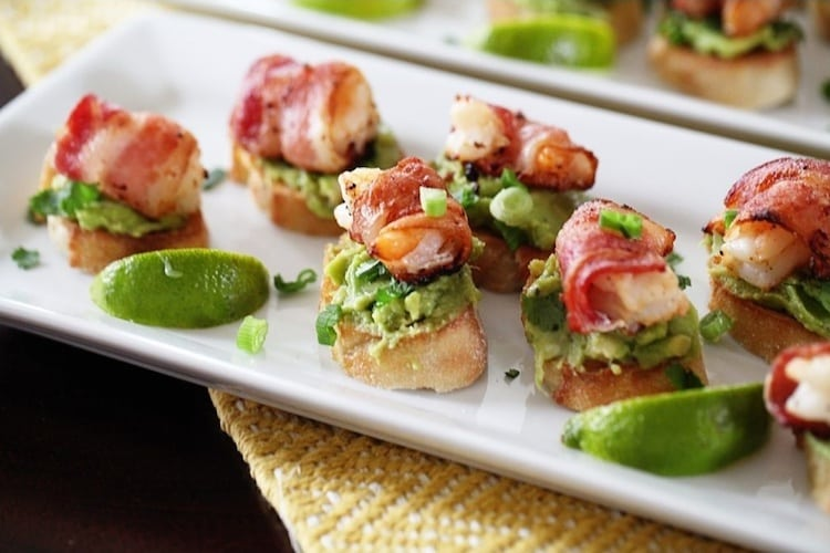 Shrimp wrapped in bacon and served on bread with avocado