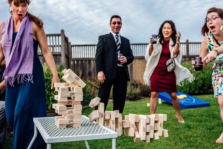 Wedding guests play Jenga at reception