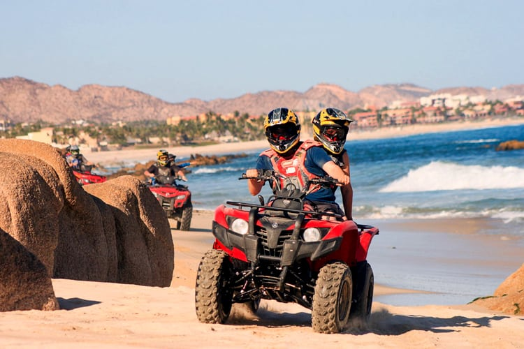 Cabo Honeymoon Guide - couple riding an ATV