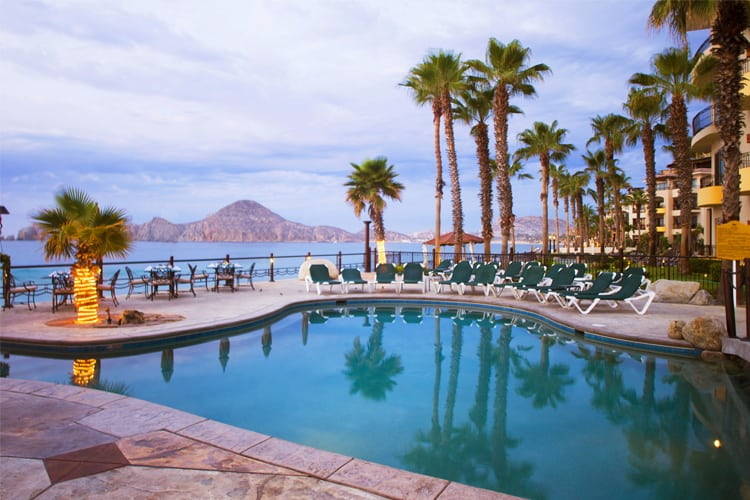 Mexico Honeymoon Guide - Cabo view of pool, palm trees and ocean