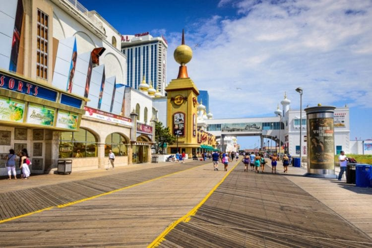 Atlantic City, New Jersey, USA - September 8, 2012: Tourists walk on the boardwalk in Atlantic City
