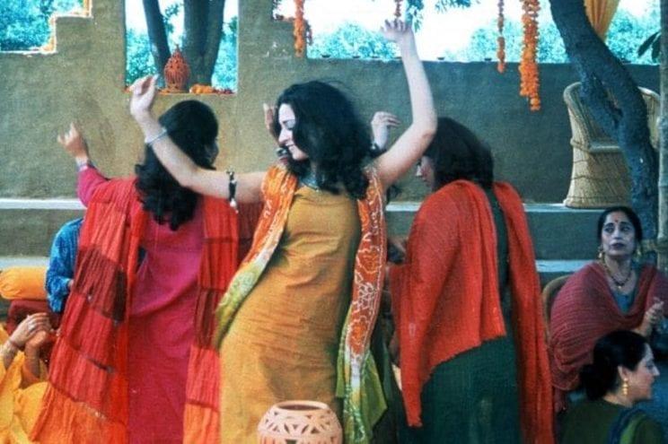 Indian women dance in a scene from Monsoon Wedding.