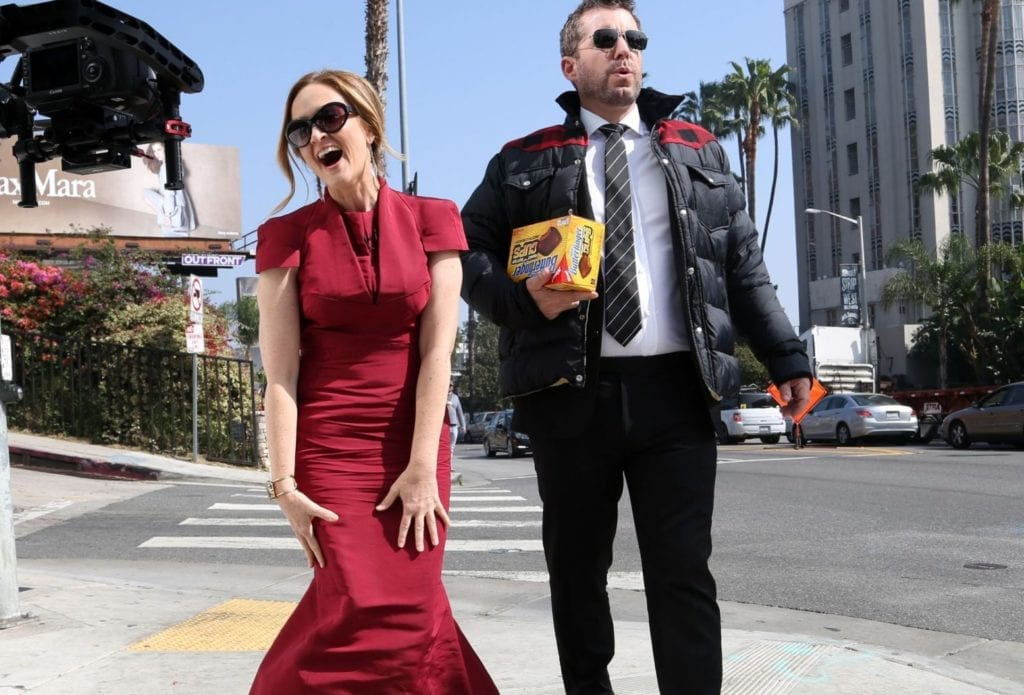 Samantha Bee and Jason Jones pose on the street, with a box of Mallowmars