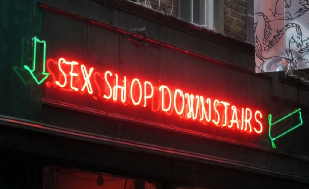 A neon sign advertising a sex shop