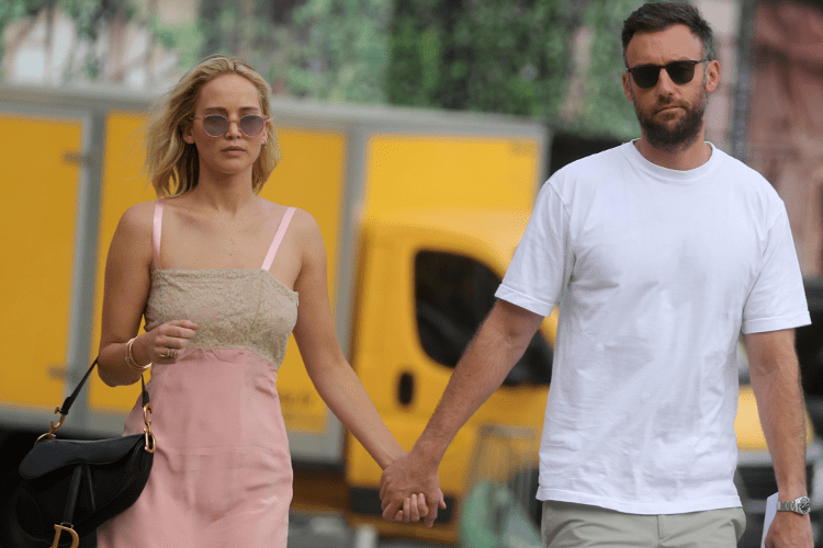 Jennifer Lawrence walks down the street with her fiance.