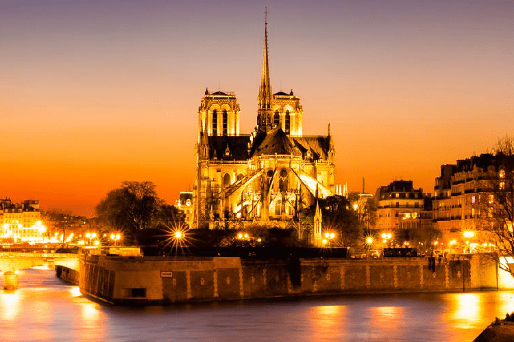 The Cathedral of Notre Dame in Paris, as seen from the Ile Saint Louis, at sunset.